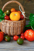 Fresh vegetables, tomatoes in a basket — Stok fotoğraf