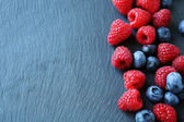 Berry mix on the slate background — Stock Photo