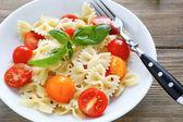 Nutritious pasta with tomato slices — Stock Photo