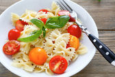 Nutritious pasta with tomato slices — Stock Photo