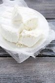 Cottage cheese on white gauze — Stock Photo