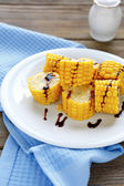 Fresh boiled corn slices on a plate — Foto de Stock