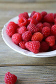 Fragrant fresh raspberries in a bowl — Stock Photo