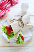 Fresh vegetables wrapped in pita bread — Stock Photo