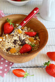 Granola with ripe strawberries in a bowl — Stock Photo