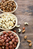 Assorted nut in  bowls — Stock Photo