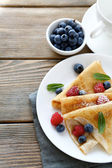 Crepes with blueberries and raspberries — Stock Photo