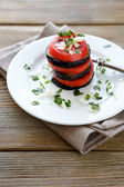 Fried eggplant with tomatoes in the stack — Photo