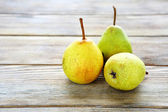 Three ripe pears on the boards — Stock Photo