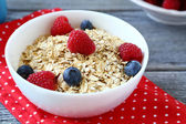 Oat flakes with berries — Stock Photo