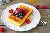 Soft waffles with berries for breakfast — Stock Photo
