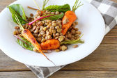 Green lentils and roasted young carrots — Stock Photo