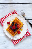 Waffles with berries top view — Photo