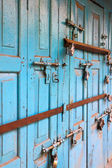 Colorful ancient door with locks — Stock Photo