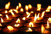 Lit candles — Stockfoto