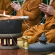 Praying thai bhuddhist monks — Stock Photo