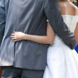 Newlywed put their arms around each others waist — Stock Photo #34855497