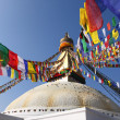 Bodhnath stupa with colorful flag — Stock Photo