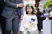 Cute little flower girl in the wedding ceremony — Stock Photo