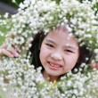 Cute little girl showing flower tiara — Stock Photo #34864035