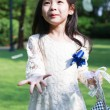 Stock Photo: Cute little flower girl in wedding ceremony