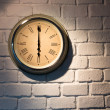 Stock Photo: Vintage clock on a white brick wall