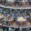 Colourful cupcakes on cakestand in a wedding party — Photo