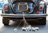 Just married sign and cans attached — Stock Photo