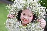 Cute little girl showing a flower tiara — Stock Photo