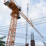 Crane at construction site in Bangkok urban area — Stock Photo