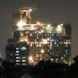 Construction site at night in Bangkok urban area — Stock Photo