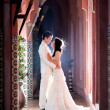 In love bride and groom are posing in romantic emotion — Stockfoto