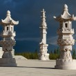 Three chinese style stone lantern with dark cloud — Stock Photo
