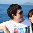 Happy asian couple on a sailing boat — 图库照片