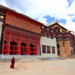 Tibetan monk is walking in Songzanlin Monastery in Zhongdian (Sh — Stock Photo