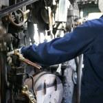 Stream train worker inside the cockpit — Stock Photo