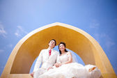 In love bride and groom are posing in romantic emotion on top of — Stock Photo