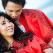 In love young couple in romantic emotion with similar red dre — Stock Photo #34920915