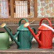 Colorful watering cans — Stock Photo #34921417