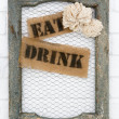 Old picture frame with eat and drink labels — Stock Photo