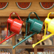 Colorful watering cans — Stock Photo #34922539