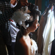 Beautiful bride is making up for the wedding — Stock Photo