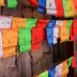 Colorful prayer flags with wooden wall in background, Shangri-La — Stock Photo