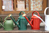 Colorful watering cans — Foto de Stock