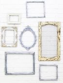 Vintage picture frames on white brick wall background — Stock Photo