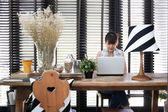 Young asian working woman is using a laptop with vintage decorat — Stock Photo
