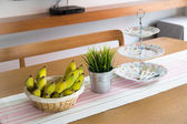 Banana on wooden table — Stock Photo