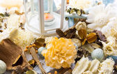 Dried flowers with lamp and candle — Stock Photo