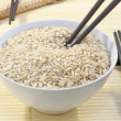 Bowl of rice and chopstick — Stock Photo