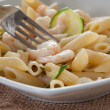 Penne with zucchinis and shrimp — Stock Photo